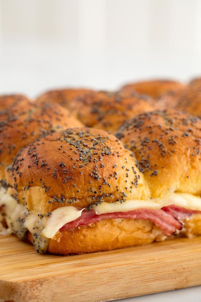 "<p>Always a party fave.</p><p>Get the recipe from <a href=""https://www.delish.com/cooking/recipe-ideas/recipes/a58447/ham-cheese-sliders-recipe/"" target=""_blank"">Delish</a>.</p>"