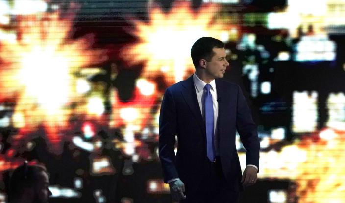 Pete Buttigieg walks off stage during a break at the Democratic presidential debate on Friday. (Brian Snyder/Reuters)