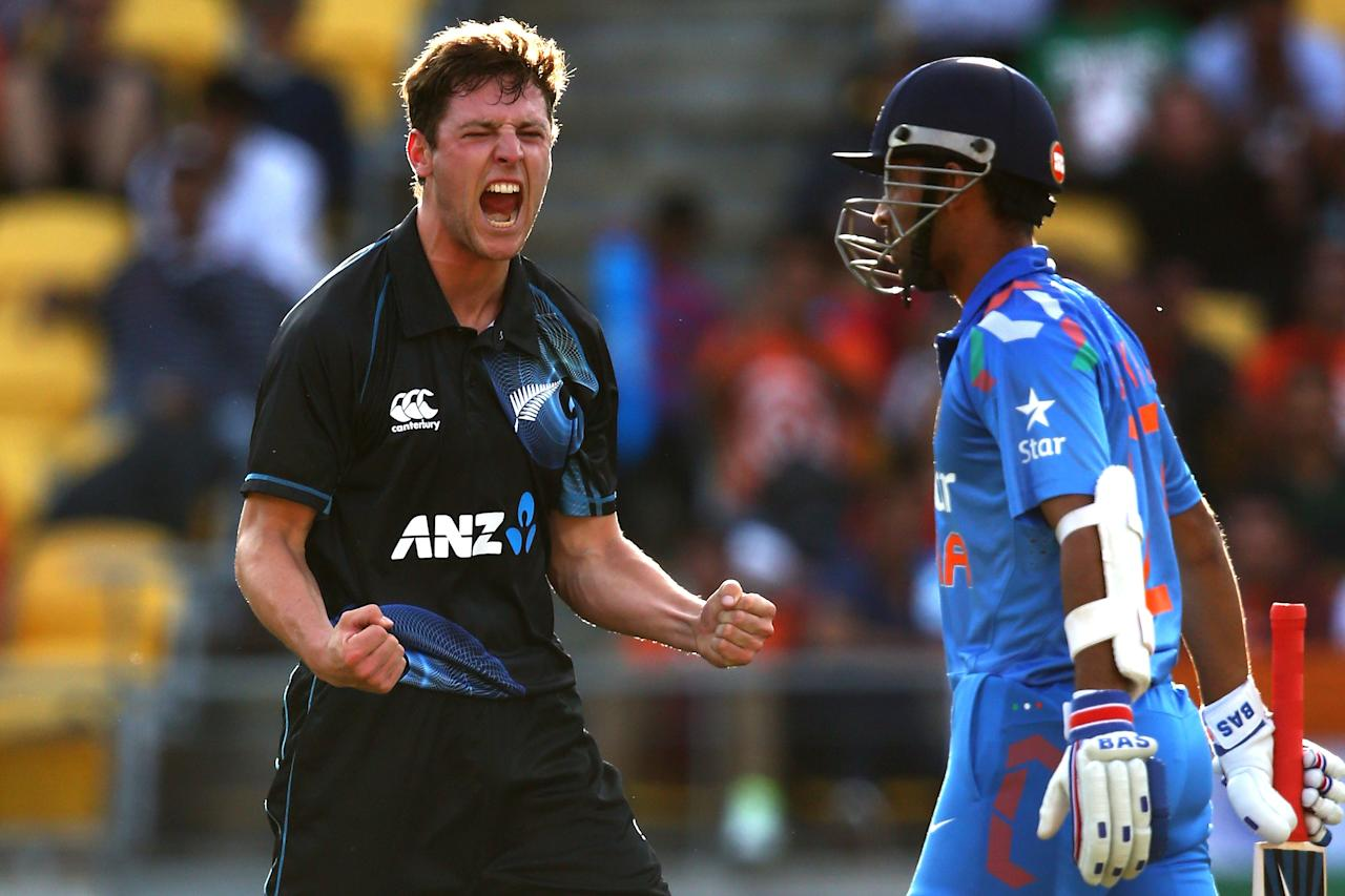 WELLINGTON, NEW ZEALAND - JANUARY 31:  Matt Henry of New Zealand celebrates his wicket of Ajinkya Rahane of India (R) during Game 5 of the men's one day international between New Zealand and India at Westpac Stadium on January 31, 2014 in Wellington, New Zealand.  (Photo by Phil Walter/Getty Images)