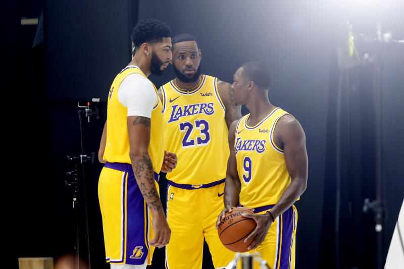 Los Angeles Lakers forwards Anthony Davis, left, LeBron James, center, and guard Rajon Rondo, right, pose for photos during the NBA basketball team's media day in El Segundo, Calif., Friday, Sept. 27, 2019. (AP Photo/Ringo H.W. Chiu)