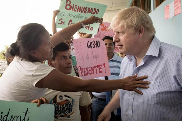 Foreign Secretary Boris Johnson meets pupils, parents and staff during a visit to the village school in Santa Marta (PA)