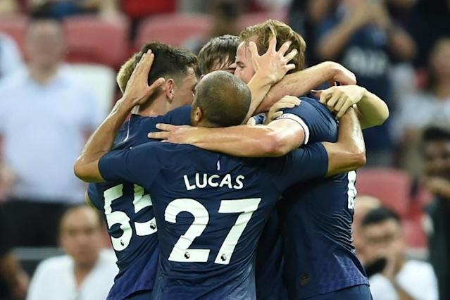 Tottenham's Harry Kane (R) is congratulated by teammates after scoring the decider in their pre-season friendly against Juventus (AFP Photo/Roslan RAHMAN)
