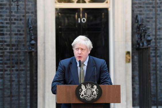 Boris Johnson speaks from outside 10 Downing Street after being returned to power (REUTERS)