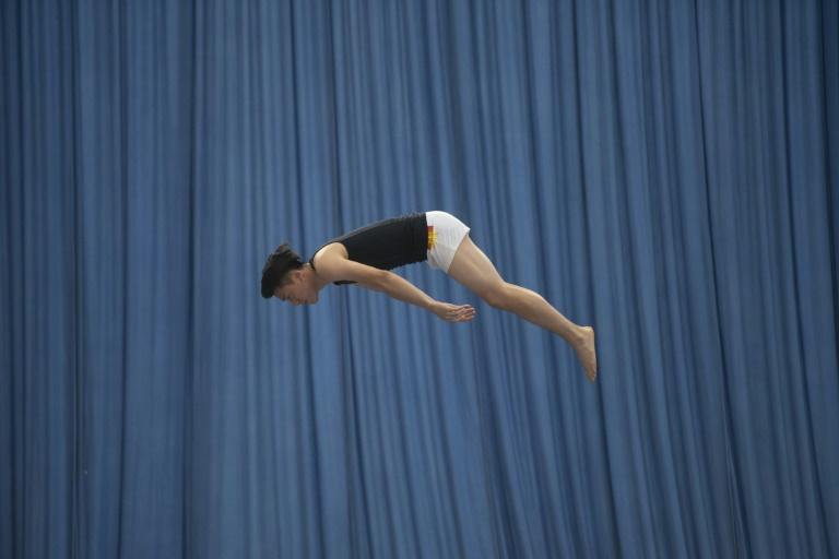 Dong Dong will participate in the 2018 Asian Games that begin in Jakarta on Saturday, and Dong will attempt to become the first trampolinist to win three golds in a row after winning the individual men's event in 2010 and 2014