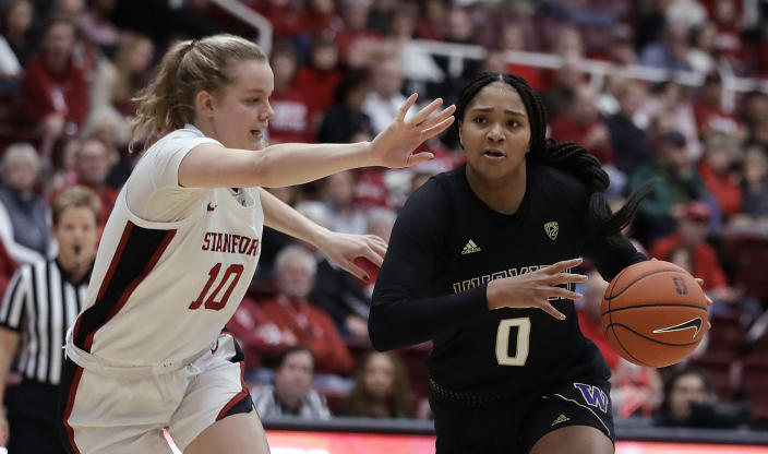 Washington's Quay Miller, right, drives the ball against Stanford's Alyssa Jerome (10) during the first half of an NCAA college basketball game Sunday, Jan. 5, 2020, in Stanford, Calif. (AP Photo/Ben Margot)