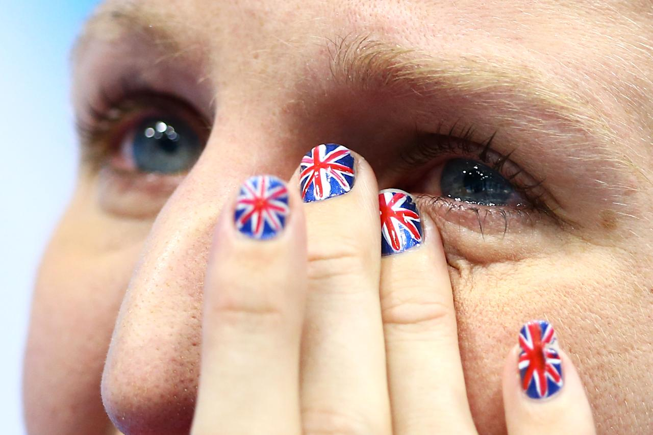 LONDON, ENGLAND - AUGUST 03:  Bronze medallist Rebecca Adlington shows her emotion following the podium for the medal ceremony for the Women's 800m Freestyle on Day 7 of the London 2012 Olympic Games at the Aquatics Centre on August 3, 2012 in London, England.  (Photo by Al Bello/Getty Images)