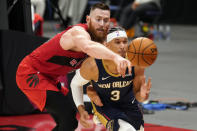 Toronto Raptors center Aron Baynes (46) knosk the ball away from New Orleans Pelicans guard Josh Hart (3) during the second half of an NBA basketball game Wednesday, Dec. 23, 2020, in Tampa, Fla. (AP Photo/Chris O'Meara)