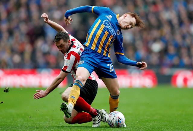 "Soccer Football - Checkatrade Trophy Final - Lincoln City vs Shrewsbury Town - Wembley Stadium, London, Britain - April 8, 2018 Lincoln City's Lee Frecklington in action with Shrewsbury Town's Jon Nolan Action Images/Matthew Childs EDITORIAL USE ONLY. No use with unauthorized audio, video, data, fixture lists, club/league logos or ""live"" services. Online in-match use limited to 75 images, no video emulation. No use in betting, games or single club/league/player publications. Please contact your account representative for further details."