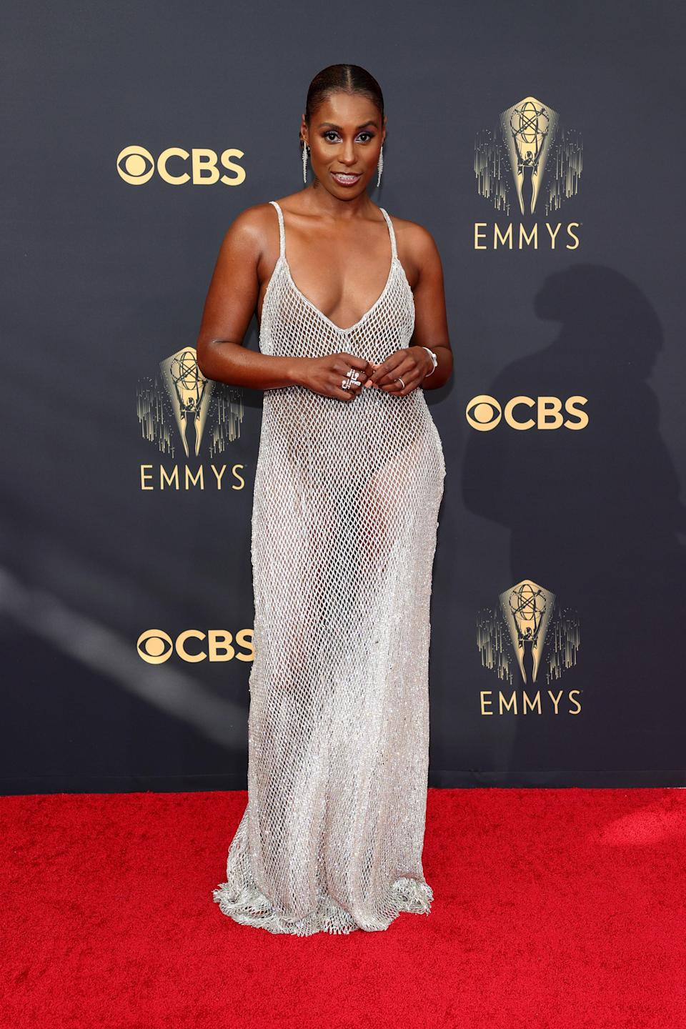 Issa looked glam in her slinky silver gown from Aliétte, pulled-back hair, and dangling diamond earrings.