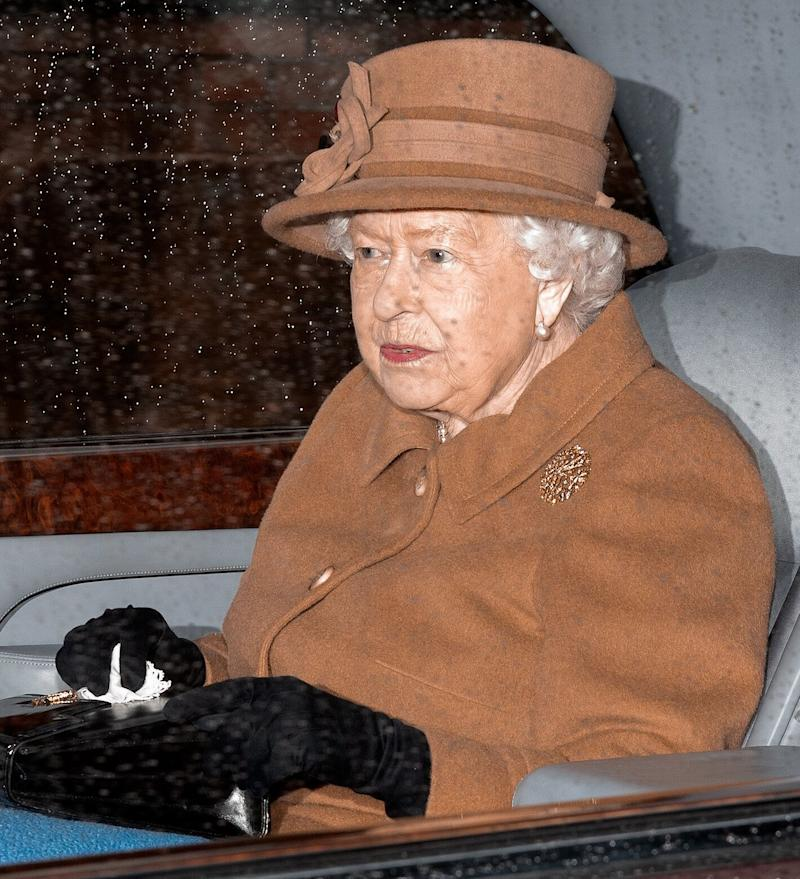 Queen Elizabeth II seen wearing a matching hue to Meghan leaving church in King's Lynn, England, on Jan. 12, days later. (Max Mumby/Indigo via Getty Images)