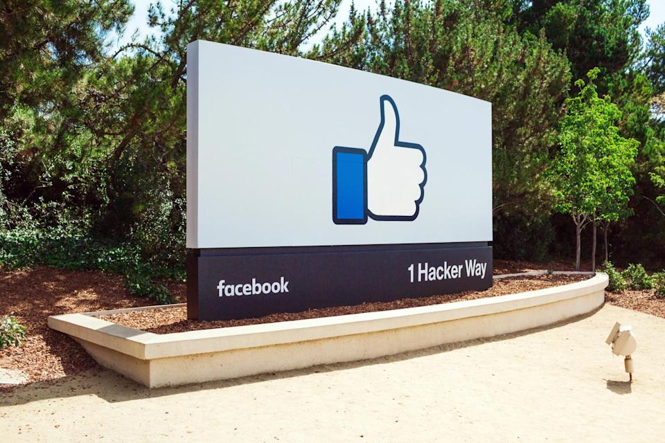 The Facebook thumbs up logo on the street sign at the entrance to its headquarters.