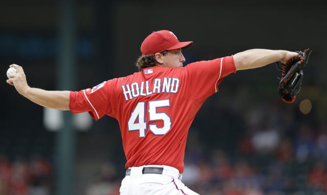 Texas Rangers starting pitcher Derek Holland throws during the first inning of a baseball game against the Los Angeles Angels Saturday, Sept. 28, 2013, in Arlington, Texas. (AP Photo/LM Otero)