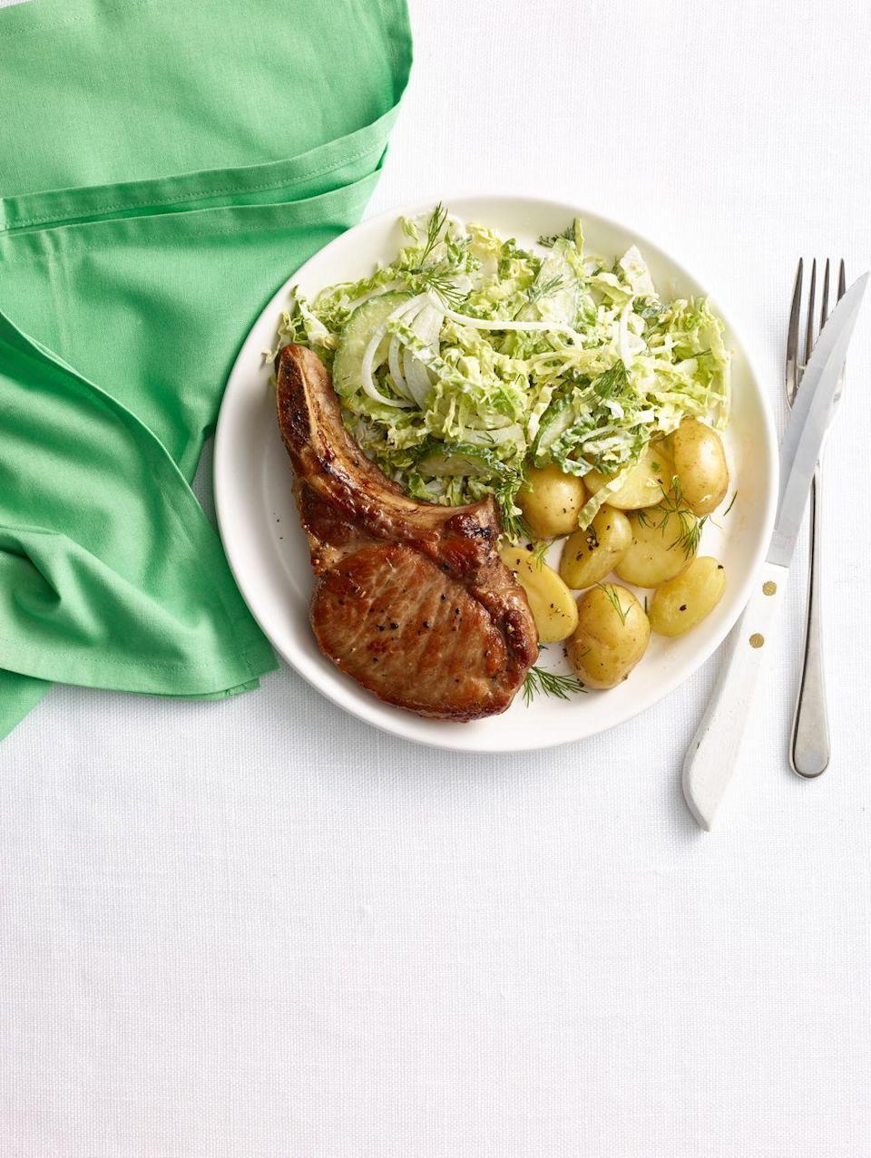 """<p>Tender pork, crunchy cabbage, and creamy potatoes — talk about a fully balanced weekday dinner.</p><p><em><a href=""""https://www.goodhousekeeping.com/food-recipes/a14880/pork-chops-horseradish-cabbage-cucumber-slaw-recipe-wdy0315/"""" rel=""""nofollow noopener"""" target=""""_blank"""" data-ylk=""""slk:Get the recipe for Pork Chops with Horseradish Cabbage and Cucumber Slaw »"""" class=""""link rapid-noclick-resp"""">Get the recipe for Pork Chops with Horseradish Cabbage and Cucumber Slaw »</a></em></p>"""