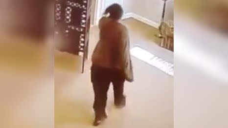 The woman casually leaves the room with Mrs Hicks' rings. Source: YouTube/David Dustin Chavez