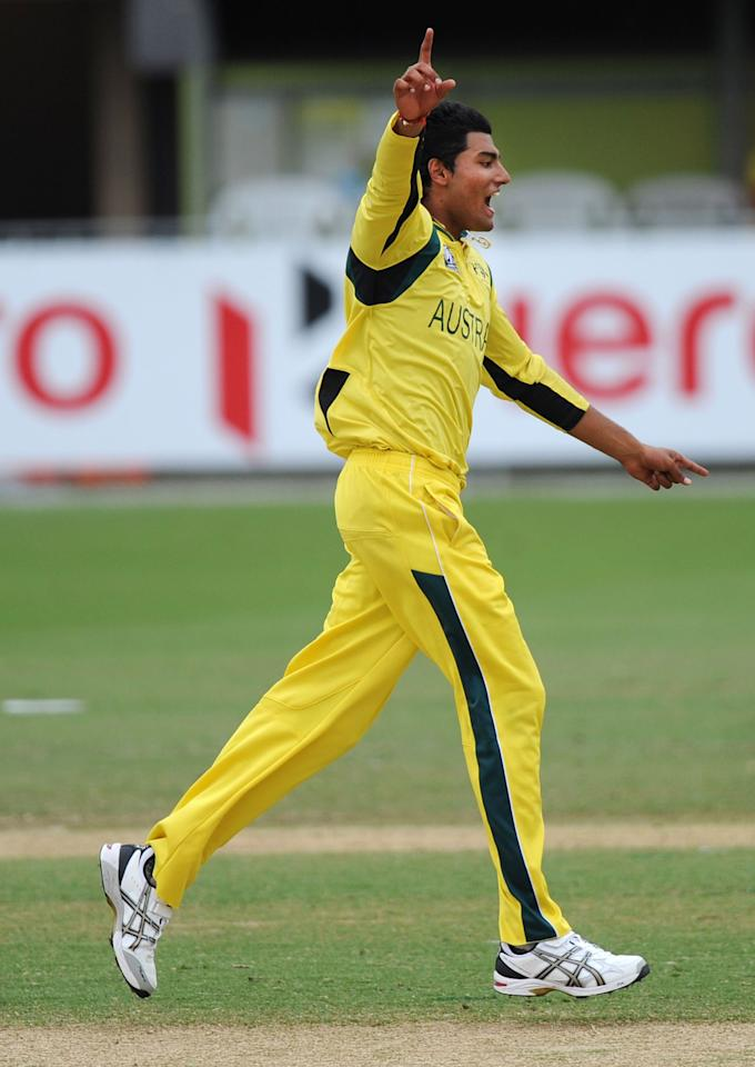 TOWNSVILLE, AUSTRALIA - AUGUST 21:  Gurinder Sandhu of Australia celebrates taking the wicket of Theunis De Bruyn of South Africa during the ICC U19 Cricket World Cup 2012 Semi Final match between Australia and South Africa at Tony Ireland Stadium on August 21, 2012 in Townsville, Australia.  (Photo by Malcolm Fairclough-ICC/Getty Images)