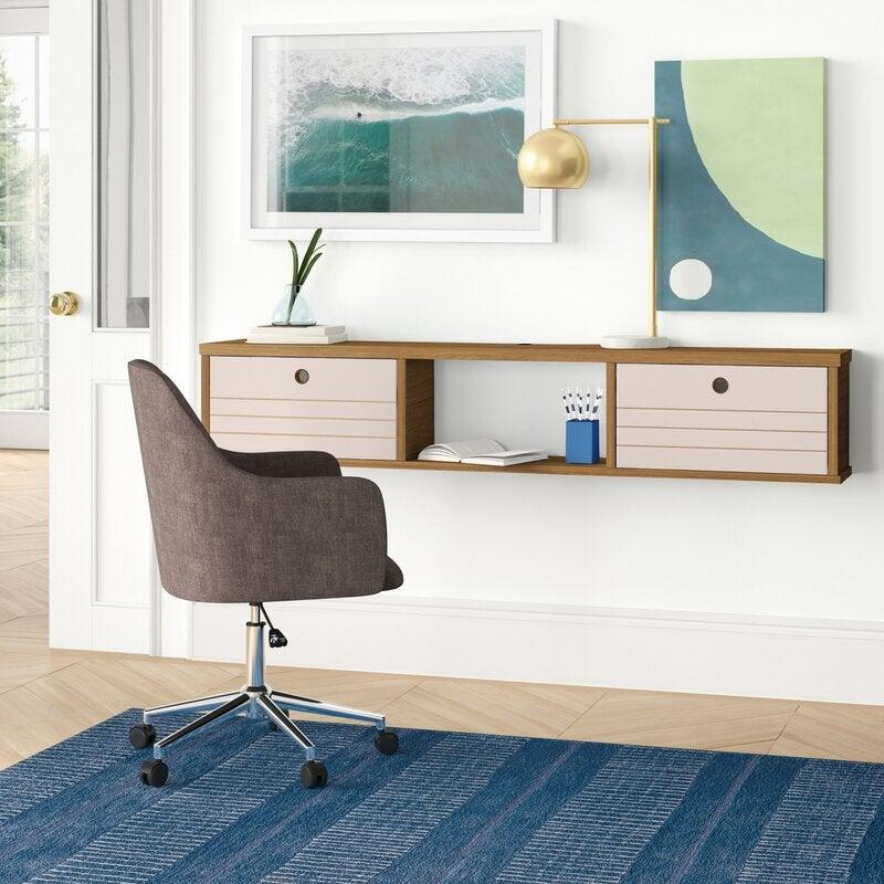 "<h3><a href=""https://www.wayfair.com/furniture/pdp/foundstone-hayward-floating-desk-w001958187.html"" rel=""nofollow noopener"" target=""_blank"" data-ylk=""slk:Foundstone Hayward Floating Desk"" class=""link rapid-noclick-resp"">Foundstone Hayward Floating Desk</a></h3><br><strong>When your bedroom is also your office</strong>: Meet the space-saving champion that is this wall-mounted desk meets vanity — built to support everything from your workspace essentials to your beauty routine in elevated style.<br><br><strong>Foundstone</strong> Hayward Floating Desk, $, available at <a href=""https://go.skimresources.com/?id=30283X879131&url=https%3A%2F%2Fwww.wayfair.com%2Ffurniture%2Fpdp%2Ffoundstone-hayward-floating-desk-w001958187.html"" rel=""nofollow noopener"" target=""_blank"" data-ylk=""slk:Wayfair"" class=""link rapid-noclick-resp"">Wayfair</a>"
