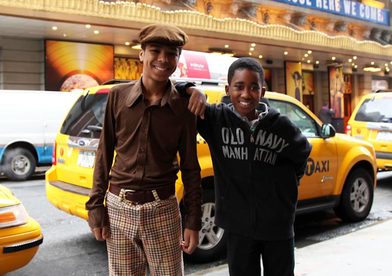 """This March 25, 2013 photo shows actors Jibreel Mawry, left, and Raymond Luke Jr. posing outside the Lunt-Fontanne Theatre in New York, where their show """"Motown: The Musical,"""" is playing. The two 12-year-olds are alternating taking on the roles of young Michael Jackson, young Stevie Wonder and a young Berry Gordy. (AP Photo/Mark Kennedy)"""