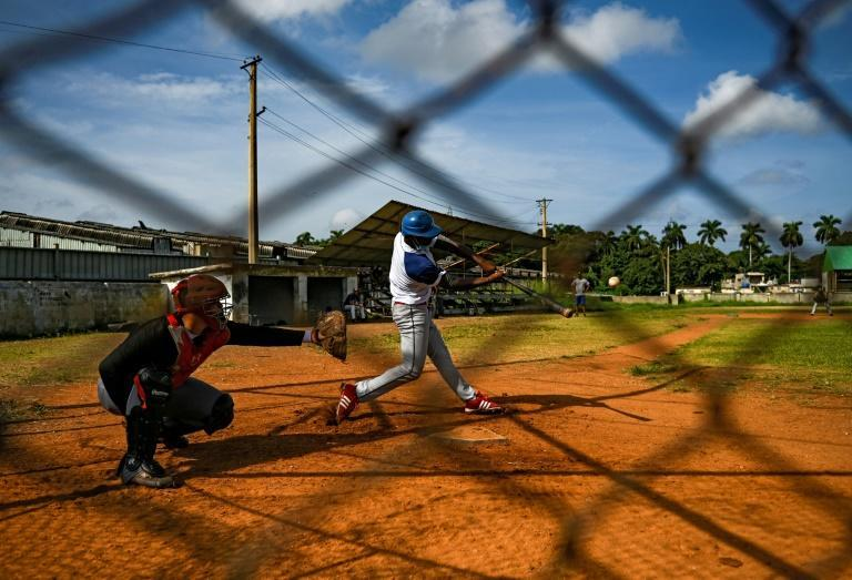 Baseball in Cuba's national pastime, but a record number of national team players has defected in 2021 (AFP/YAMIL LAGE)