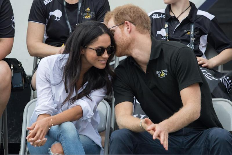 Meghan and Harry charmed fans around the world when they finally put on a PDA-packed display at the Games. Photo: Getty