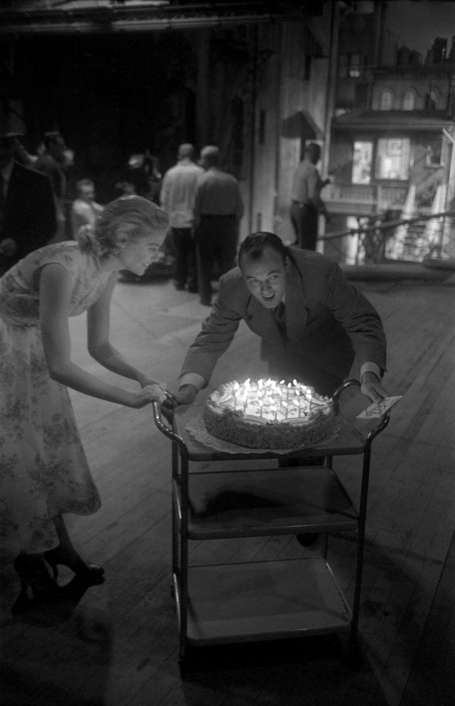 <p>The young film star is treated to a birthday celebration on the set of <em>Rear Window </em>in 1953. The actress was presented a cake on the Paramount lot in honor of her 24th birthday. </p>
