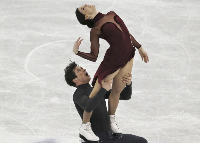Tessa Virtue and Scott Moir of Canada perform during the Ice Dance Free Dance event at the ISU Grand Prix of Figure Skating Final in Nagoya, central Japan, Saturday, Dec. 9, 2017. (AP Photo/Koji Sasahara)