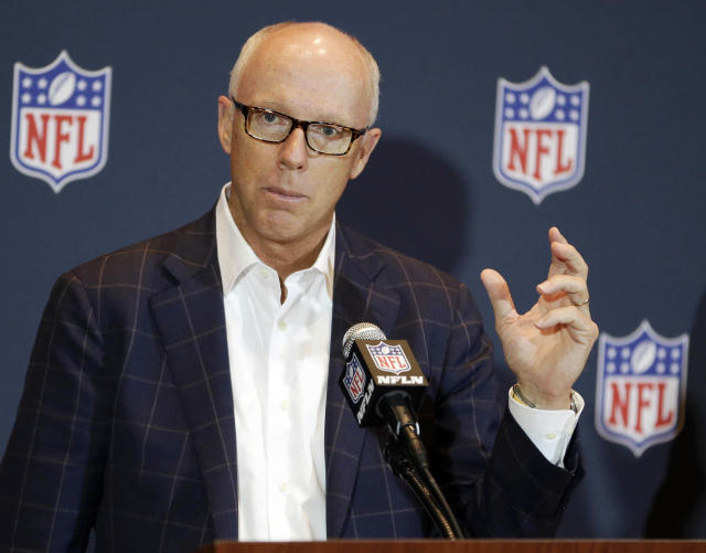 FILE - In this March 26, 2014 file photo, Atlanta Falcons President, CEO and NFL competition committee member Rich McKay speaks about rule changes during a news conference at the NFL football annual meeting in Orlando, Fla. The NFL has passed a new rule for this season that says any player who initiates contact with his helmet is subject to ejection, Tuesday, May 22, 2018. All calls will be subject to an in-game video review conducted in New York. The new rule can apply to both offensive and defensive players. (AP Photo/John Raoux, File)