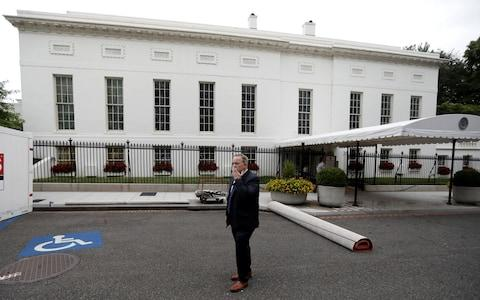 Former White House Press Secretary and Communications Director Sean Spicer stands alone on West Executive Drive outside the West Wing (Rear) during a press tour of renovations at the White House in Washington, U.S. August 11, 2017 - Credit: Reuters