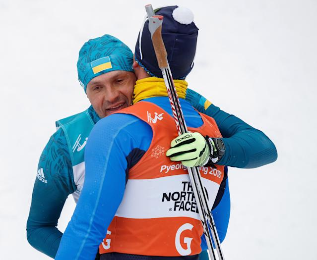 Vitaliy Luk'yanenko of Ukraine and his guide Ivan Marchyshak congratulate each other after winning in the Biathlon Visually Impaired Men's 15km at the Alpensia Biathlon Centre. The Paralympic Winter Games, PyeongChang, South Korea, Friday 16th March 2018. OIS/IOC/Simon Bruty/Handout via Reuters