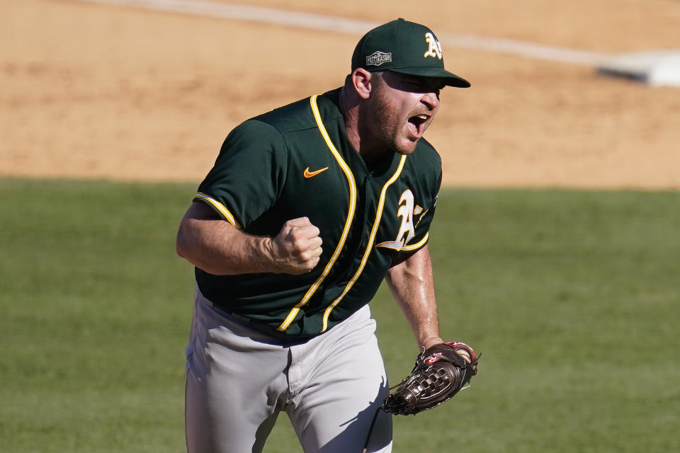 Oakland Athletics pitcher Liam Hendriks reacts after striking out Houston Astros' Josh Reddick during the eighth inning of Game 3 of a baseball American League Division Series in Los Angeles, Wednesday, Oct. 7, 2020. (AP Photo/Marcio Jose Sanchez)