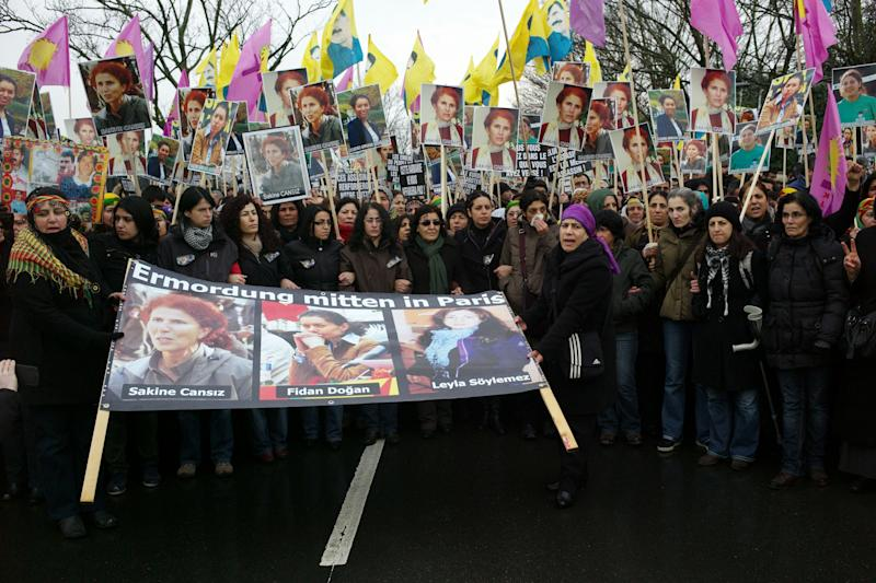 Kurdish people gather prior to a memorial ceremony for the three activists, in Villiers le Bel, north of Paris, Tuesday, Jan. 15, 2013, before their bodies are sent to Turkey for burial. Three Kurdish women were shot dead at a pro-Kurdish center in Paris on Thursday Jan. 10, in what the French interior minister called an execution. (AP Photo/Thibault Camus)