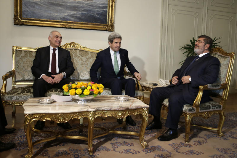 Egyptian Foreign Minister Mohammed Kamel Amr, left, U.S. Secretary of State John Kerry, center, and Egyptian President Mohamed Morsi take their seats at the starts of their meeting at the Presidential Palace in Cairo, Egypt on Sunday, March 3, 2013. Kerry met with Egypt's president Sunday, wrapping up a visit to the deeply divided country with an appeal for unity and reform. The U.S. is deeply concerned that continued instability in Egypt will have broader consequences in a region already rocked by unrest. (AP Photo/Jacquelyn Martin, Pool)