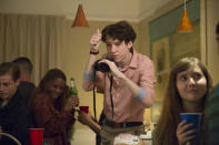 <p>Teen peeping tom Tyler Down stalked Hannah and took photos of her from outside her bedroom window. This 17-year-old yearbook photographer later sent out group-texts of Hannah kissing another girl. (Photo: Netflix) </p>