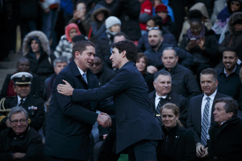 TORONTO, ON - Prime Minister Justin Trudeau, right, shakes hands with the leader of the Conservative Party of Canada, Andrew Scheer. (Photo by Cole Burston/Getty Images)