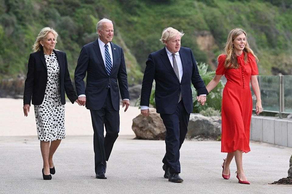 US President Joe Biden and his wife, Jill Biden, and British Prime Minister Boris Johnson and his wife, Carrie Johnson (right), walk in Cornwall on Thursday before the start of the G7 summit. Photo: PA Wire/dpa