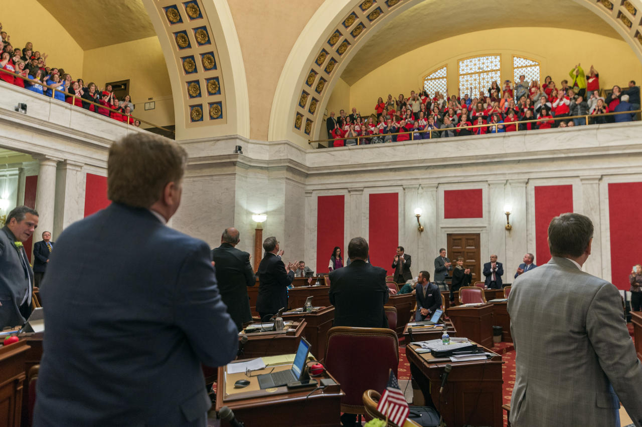 <p>State senators acknowledge the cheers of teachers and school personnel after the passage of a bill to increase pay of state employee by 5 percent at the capitol in Charleston, W.Va., on Tuesday, March 6, 2018. (Photo: Craig Hudson/Charleston Gazette-Mail via AP) </p>