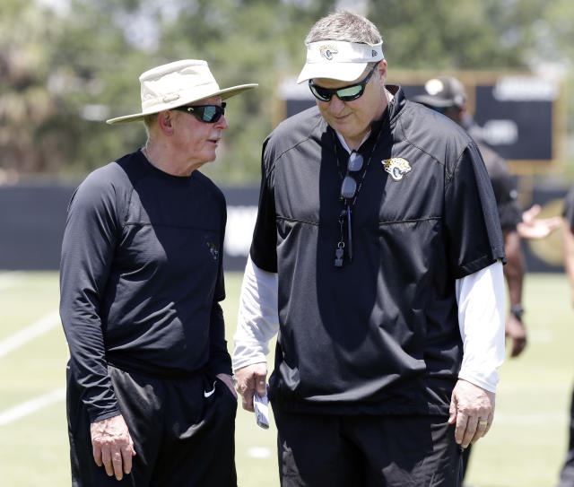 Jaguars' head of football operations Tom Coughlin, left, didn't exactly give head coach Doug Marrone, right, a vote of confidence. (AP/John Raoux)