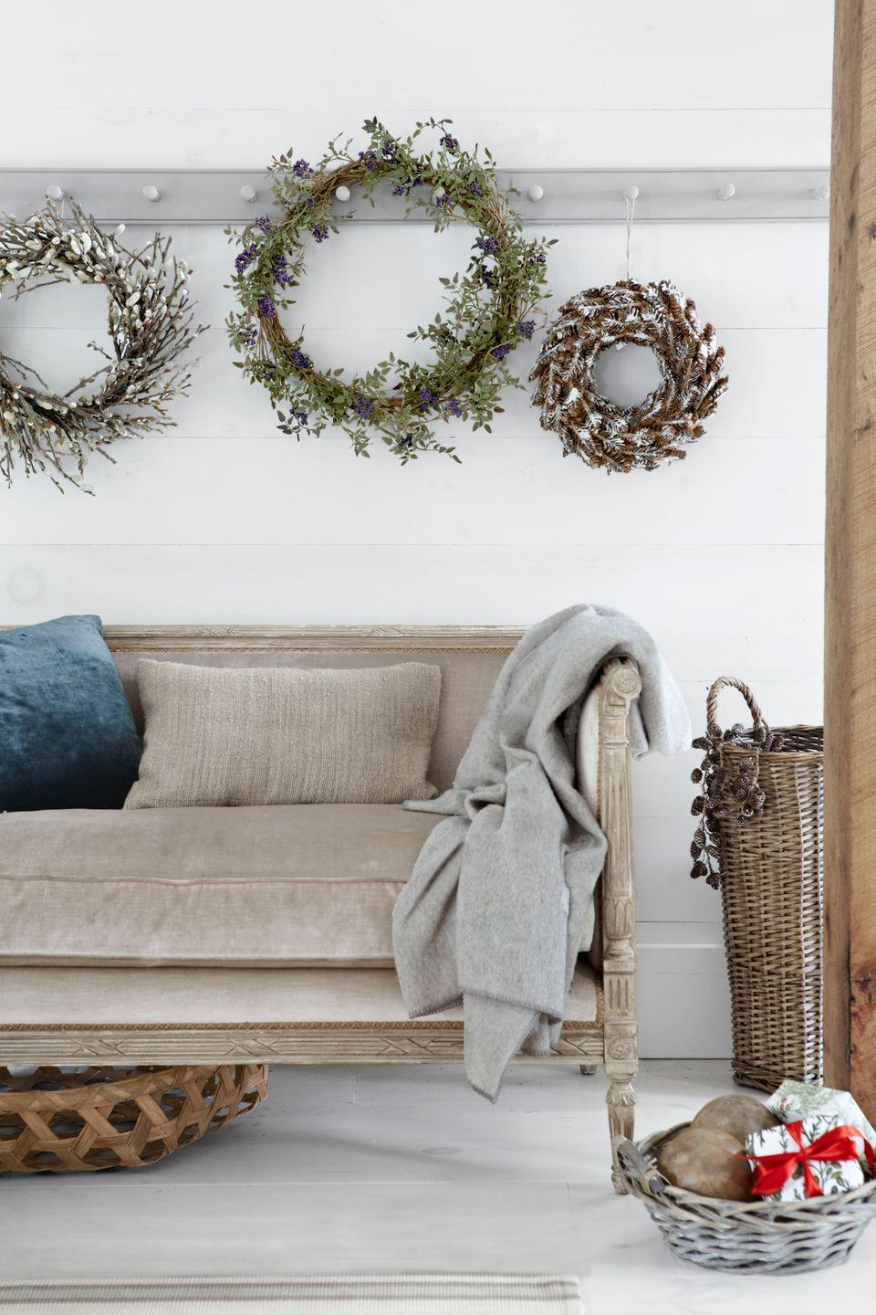 """<p>Go beyond evergreen boughs and bright-red bows—these wreaths are stunning in their simplicity.</p><p><a class=""""link rapid-noclick-resp"""" href=""""https://www.amazon.com/s/ref=nb_sb_noss_2?url=search-alias%3Dgarden&field-keywords=christmas+wreath&rh=n%3A1055398%2Ck%3Achristmas+wreath&tag=syn-yahoo-20&ascsubtag=%5Bartid%7C10050.g.1247%5Bsrc%7Cyahoo-us"""" rel=""""nofollow noopener"""" target=""""_blank"""" data-ylk=""""slk:SHOP CHRISTMAS WREATHS"""">SHOP CHRISTMAS WREATHS</a> </p>"""