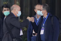 FILE - In this Feb. 2, 2021, file photo, Peter Daszak, left, bumps fists with Peter Ben Embarek before they leave the hotel with other members of a World Health Organization team for another day of field visit in Wuhan in central China's Hubei province. Daszak, part of the team investigating the origins of the coronavirus in Wuhan, says the Chinese side granted full access to all sites and personnel they requested to visit and meet with. (AP Photo/Ng Han Guan, File)