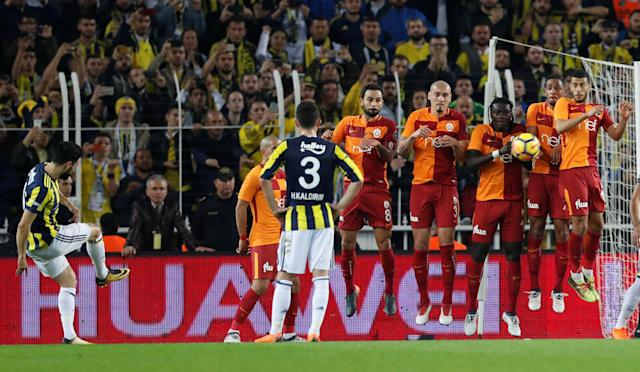 Soccer Football - Turkish Super League - Fenerbahce S.K vs Galatasaray - Sukru Saracoglu Stadium, Istanbul, Turkey - March 17, 2018 Fenerbahce's Mehmet Ekici shoots from a freekick REUTERS/Murad Sezer