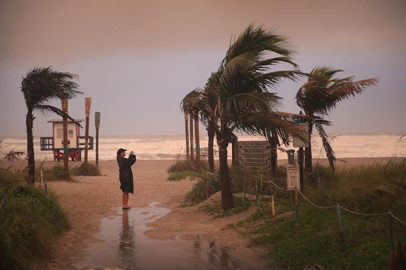 A woman takes a picture as the effects of Hurricane Dorian begin to be felt on Sept. 2, 2019 in Cocoa Beach, Fla. (Photo: Scott Olson/Getty Images)