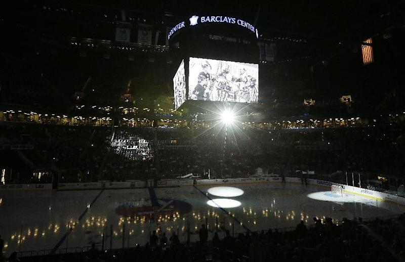 Highlights are shown on the big screen before the start of a preseason NHL hockey game between the New York Islanders and the New Jersey Devils, Saturday, Sept. 21, 2013, in New York. The match is the first ever hockey contest played at Barclays Center. (AP Photo/Julio Cortez)