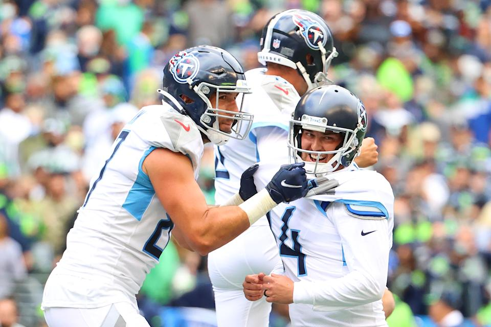 Randy Bullock and the Tennessee Titans celebrate a game-winning field goal in overtime at Seattle. (Photo by Abbie Parr/Getty Images)