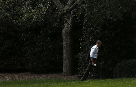 U.S. President Obama walks to the Oval Office of the White House in Washington