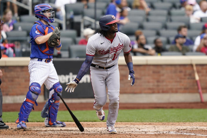 New York Mets catcher Patrick Mazeika, left, looks on as Washington Nationals' Josh Bell watches his own two-run home run, also scoring Juan Soto, during the fourth inning of a baseball game, Sunday, Aug. 29, 2021, in New York. (AP Photo/Corey Sipkin)