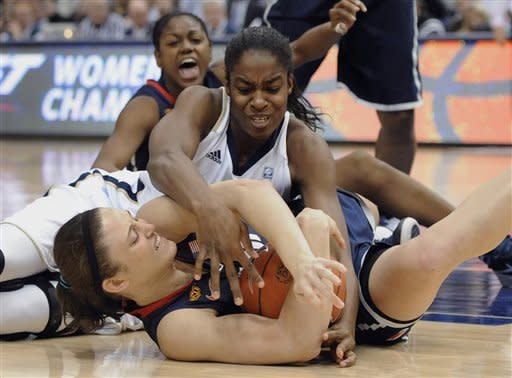 Notre Dame's Devereaux Peters, top, and Connecticut's Kelly Faris, bottom fight for possession of the ball in the second half of an NCAA college basketball game in the final of the Big East women's tournament in Hartford, Conn., Tuesday, March 6, 2012. Connecticut won 63-54. (AP Photo/Jessica Hill)