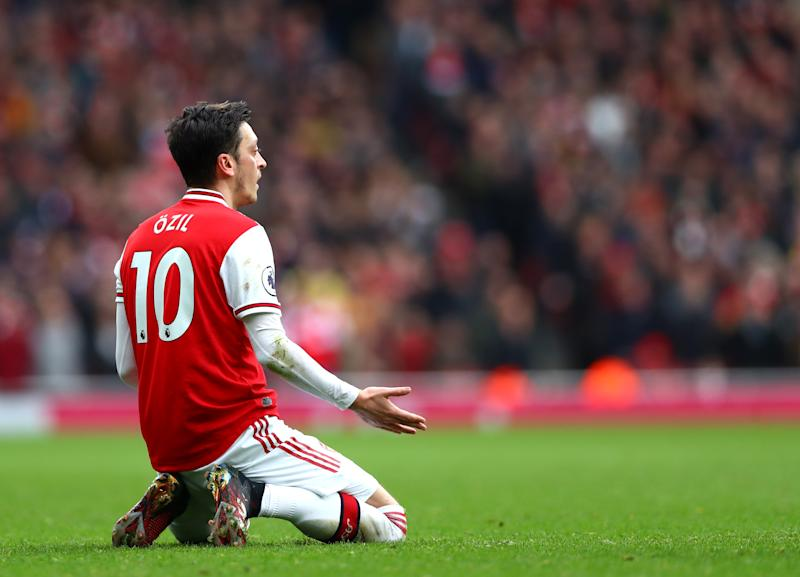 LONDON, ENGLAND - MARCH 07: Mesut Ozil of Arsenal reacts during the Premier League match between Arsenal FC and West Ham United at Emirates Stadium on March 07, 2020 in London, United Kingdom. (Photo by Chloe Knott - Danehouse/Getty Images)