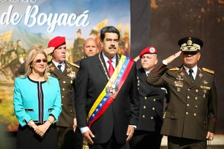 Venezuela's President Nicolas Maduro, his wife Cilia Flores and Defense Minister Vladimir Padrino arrives at the ceremony to commemorate the Bicentennial of the Boyaca Battle at the National Pantheon in Caracas