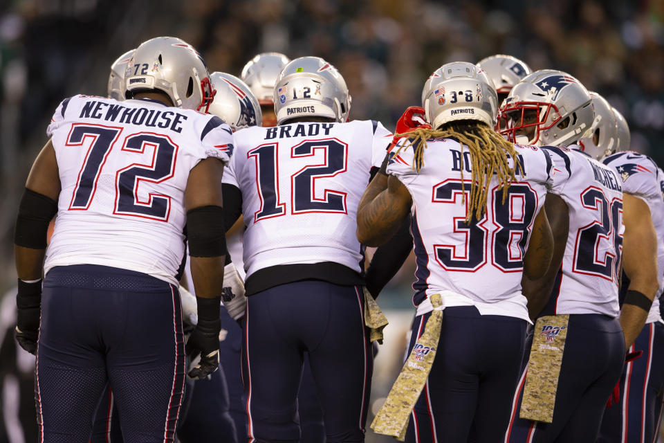 The team that plays together...gets sick together? Several members of the New England Patriots fell ill this week. (Mitchell Leff/Getty Images)