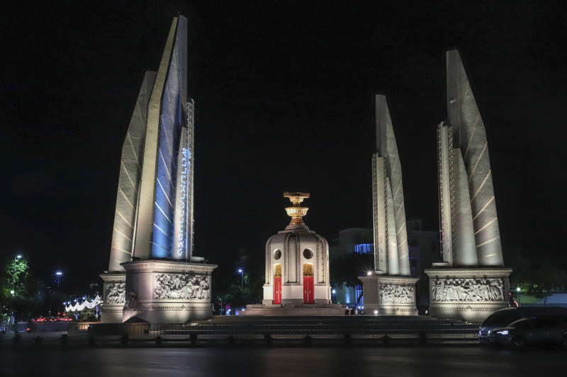 """In this Sunday, May 10, 2020. photo released by the Progressive Movement Group, shows images of """"hashtag #Finding Truth"""" relating to the 2010 civil protests projected on the pillars of the Democracy Monument in Bangkok, Thailand, ahead of the upcoming 10th anniversary of the protests and following crackdowns. (Progressive Movement Group via AP)"""