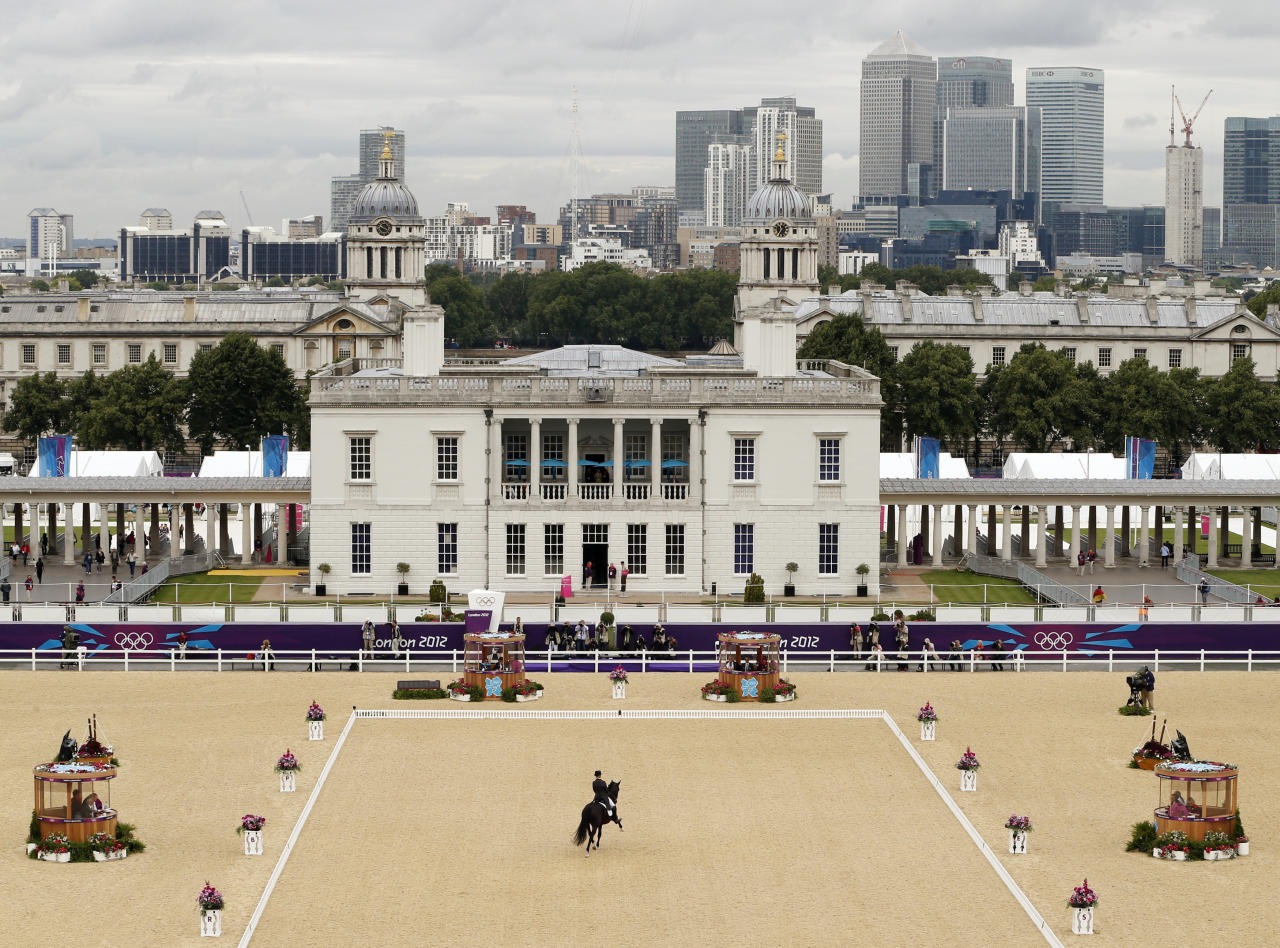 Spain's Morgan Barbancon Mestres riding Painted Black competes in the equestrian dressage individual grand prix special at the London 2012 Olympic Games in Greenwich Park August 7, 2012.             REUTERS/Mike Hutchings (BRITAIN  - Tags: SPORT EQUESTRIANISM SPORT OLYMPICS)